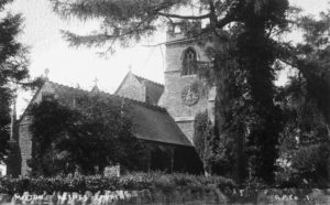 All Saints view from NW c1930 showing chimney of Victorian heating system in front of nave roof (to left of clock)