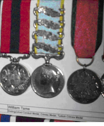 Each of these medals is engraved with William's name and regiment around the edge