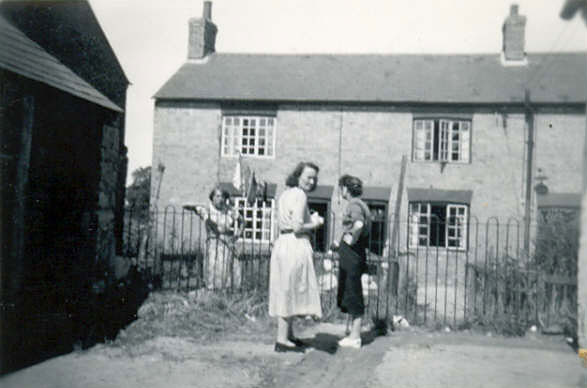 Gladstone Terrace c.1942. Archie Robertson housed his wife and sisters and their children here during the war. There were at least 10 people in the group. The lady in the pale dress was Galdys Withey, ne Robertson.