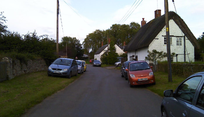 Lane and thatched house