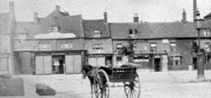 Market Place - showing the lamp mounted on the pump - 1890s