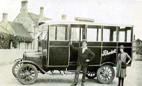 'Bob' Wesley and bus outside Olney Station